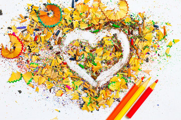 heart, three pencils and wooden shavings