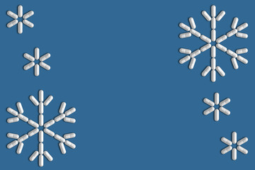 Background of a variety of tablets scattered on a blue background in the form of a silhouette snowflakes 3d illustration