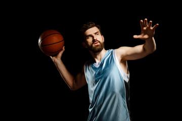 Sportsman throws a basketball