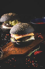 Delicious black burger with spices
