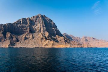 Scenic seaside surrounded by desert rocks in Khasab Oman