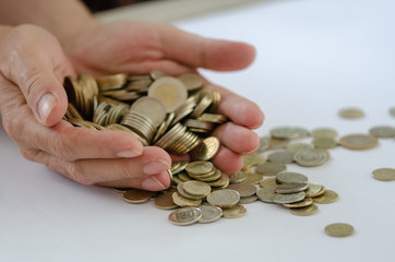 Saving .There are many coins in the male hand.