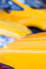 Taxi Traffic Background / Vertical close up detail of yellow taxi cars background (copy space)