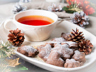 Christmas or new year card. Winter holiday composition, side view, selective focus, blue, gray background. Tea, cookies
