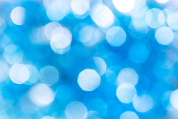 Abstract festive bright background with blue bokeh effect with copy space