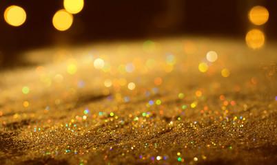 Shiny golden glitters, closeup