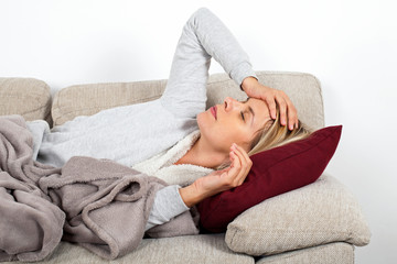 Sick woman lying on the couch