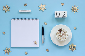 calendar December 2 cup cocoa and marshmallow, empty open notepad