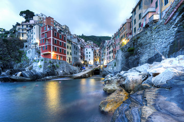 Riomaggiore of Cinque Terre, Italy - Traditional fishing village in La Spezia, situated in a coastline of Liguria of Italy. Riomaggiore is one of the five Cinque Terre travel attractions.