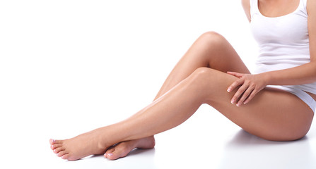 Legs of a beautiful girl on a white background
