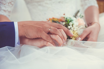 hands of bride and groom, hands of bride and groom. Concept: wedding and ceremony