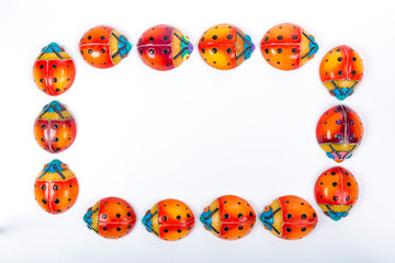 beautiful set of multicolored ladybugs forming a circle in Mexican ceramics, top view, copy space, flat lay, space for text
