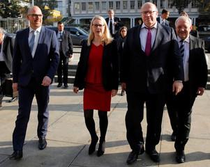 Swiss Economic Minister Johann Schneider-Ammann arrives with his counterparts Peter Altmaier of Germany, Margarete Schramboeck of Austria and Daniel Risch of Liechtenstein before a meeting in Zurich