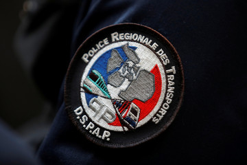 The badge with the logo of the DSPAP (Regional Transport Police) is seen during a patrol at the Gare du Nord train station in Paris