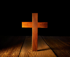 Christian wood cross on black background