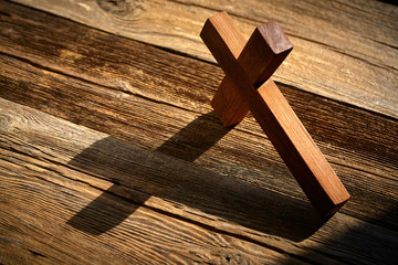 Christian cross on wood over wooden