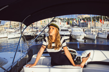 Young girl have fun and posing on yacht