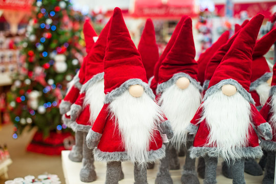 Close up Santa Claus gnome dolls and christmas stuff in the shop christmas market. Soft selective focus, copy space.