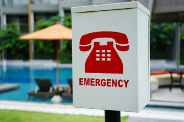 The red emergency phone box beside swimming pools