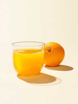 Studio shot of orange juice and fruit