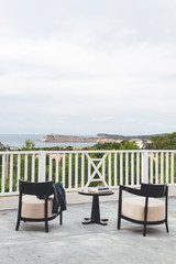 Two  seats in a terrace with sea views