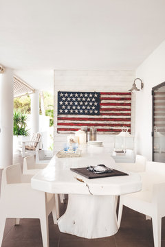 White modern terrace with dining table and united states flag
