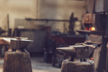 Anvil and hammer in a metal workshop