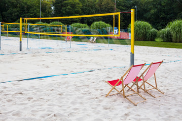 chair referee in the playground on the volleyball beach. Volleyball courts in the background