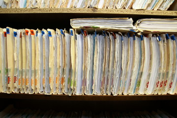 The medical records are stacked neatly in the Doctor's office.