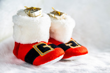 Santa Claus boots full of gifts at Christmas day