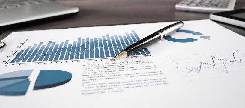 business background. financial report on the table at the businessman