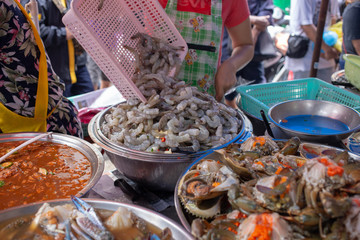 Street Food in Chinatown with Seafood include crap shrimp with egg on pickle