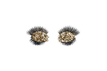 Dramatic black long false eyelashes decorated with bright sparkling golden glitter isolated on white background shot with studio light