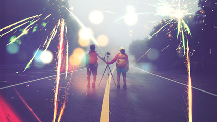 Travel nature Lover asian women and asian man Take a picture Shoot the fireworks In New Year's Mountain. Thailand