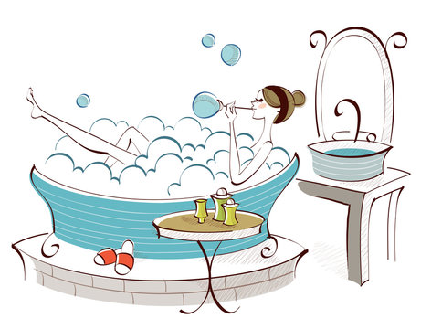 Side profile of a woman blowing soap suds in a bathtub