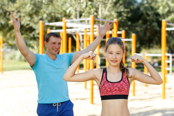 Happy girl ready for workout with father