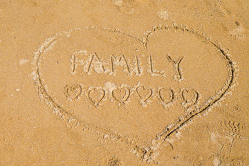 Family love written in the sand