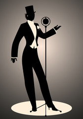 Silhouette of woman wearing hat and male clothes retro style singing in front of a vintage microphone