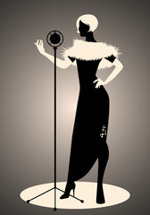 Silhouette of woman wearing retro style clothes singing in front of a vintage microphone