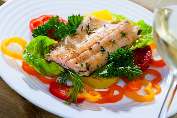 Roasted trout fillet with vegetables