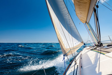 Sailing lboat at open sea in sunshine Wall mural