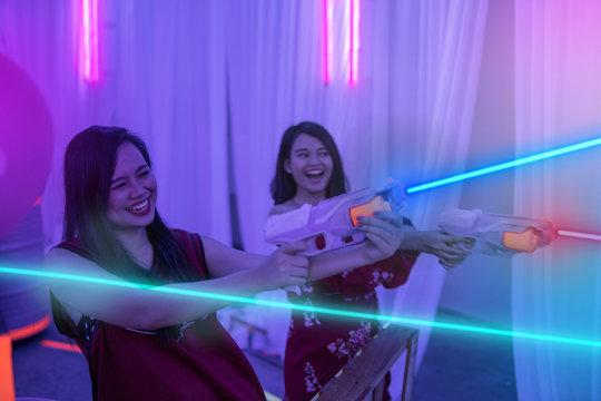 asian teenage playing laser tag indoor