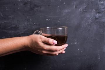 Hands with tea cup