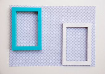 Two empty frames on paper with pattern. Space for text.