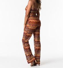 Model in a Rust Colored Lava Lamp Pants Outfit