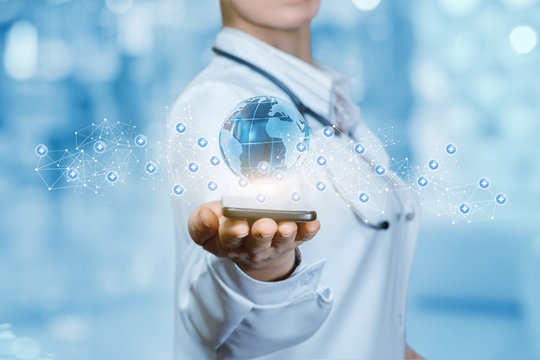 A medical worker is holding a mobile phone with the global map flying above surrounded by small molecules .