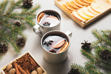Cups of mulled wine in fir branches