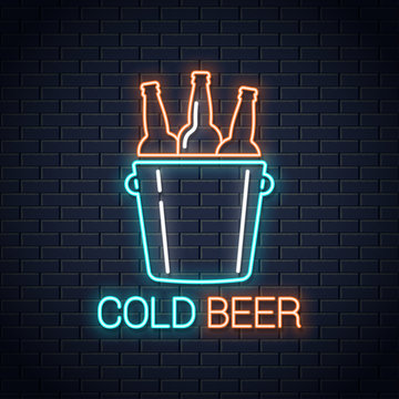 Cold beer neon banner. Beer bottles neon sign on wall background