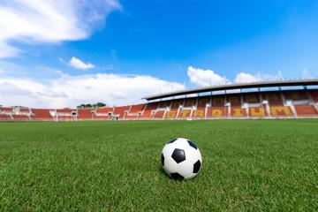 football field  ball on green grass , soccer field athletics stadium and blue sky background