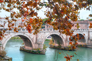 Roman stone arch bridge over the Tiber River. Bridge opposite the castle of the holy angel. Rome, Italy